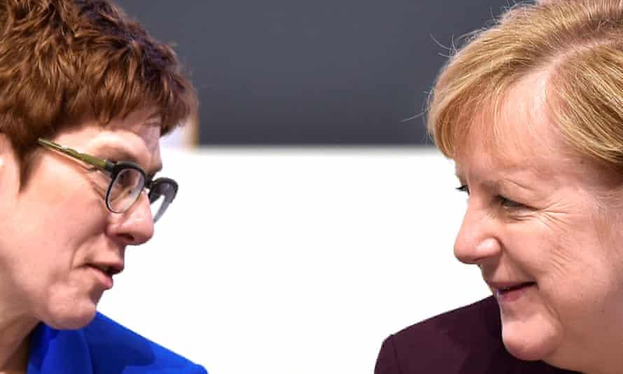Annegret Kramp-Karrenbauer  (left) and Angela Merkel at the Christian Democratic Union's party congress in Leipzig in November.