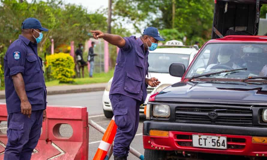 Security officers man a checkpoint at a junction in Suva on April 27, 2021, after the Fijian capital entered a 14-day lockdown.