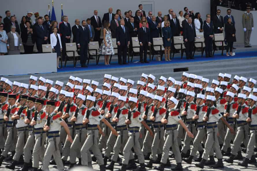 The Trumps watch the military parade in Paris alongside Emmanuel and Brigitte Macron.