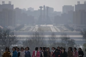 From early morning, a steady stream of citizens arrived at Mansu Hill in Pyongyang, where giant bronze statues of the two elder Kims look out over the capital