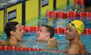 The trio of Aussie medalists Mitch Larkin, left, Bradley Woodward and Josh Beaver celebrate after the men's 200m backstroke final.