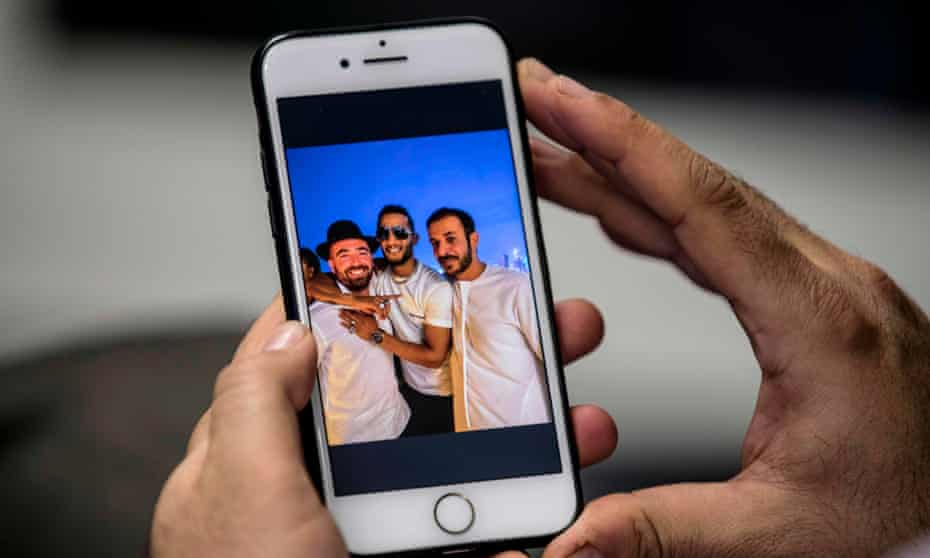 A smartphone shows the image of Mohamed Ramadan with his arm around Israeli singer Omer Adam on a Dubai rooftop