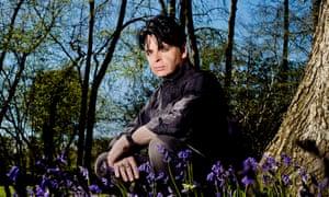 Gary Numan sitting among flowers
