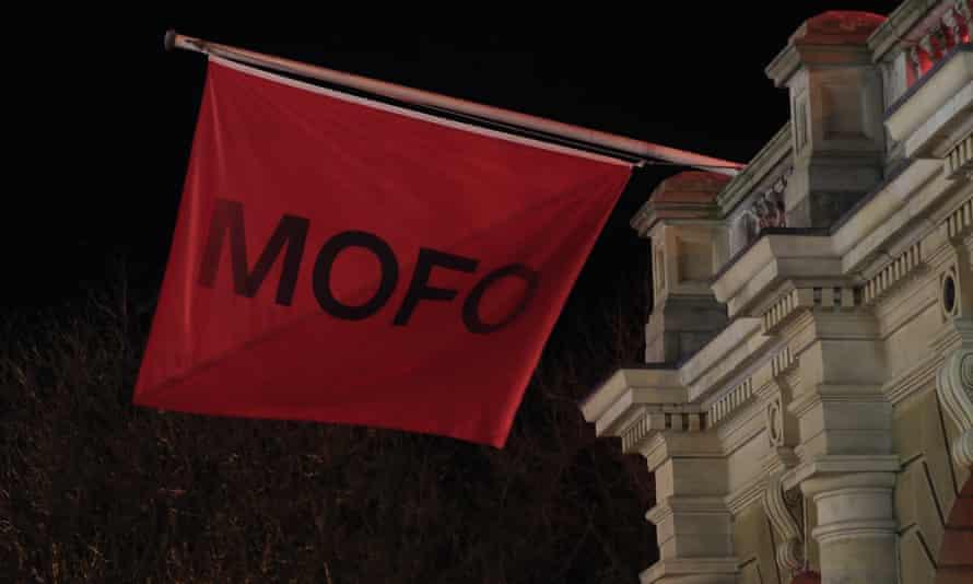 Dark Mofo's flag flies at the Hobart town hall