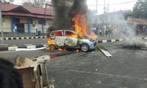 A car burns during a violent protest in Manokwari, Papua province, Indonesia on 19 August.