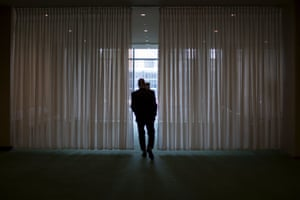 A diplomat walks to a lounge near the general assembly hall
