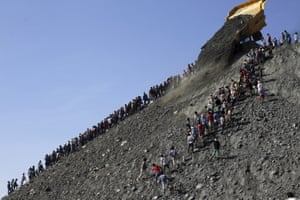 Miners search for jade stones at a mine dump at a Hpakant jade mine in Kachin state, Myanmar November 25, 2015