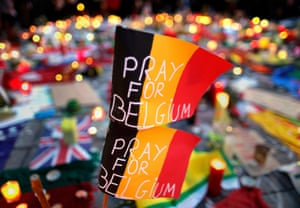 Belgian flags seen at an evening street memorial service in Brussels following the bomb attacks