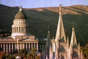 The sun sets on Utah's Capitol, left, and the angel-topped spire of the Mormon Temple