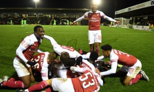 Joe Willock (standing) celebrates an Arsenal goal against Forest Green Rovers at the start of November.