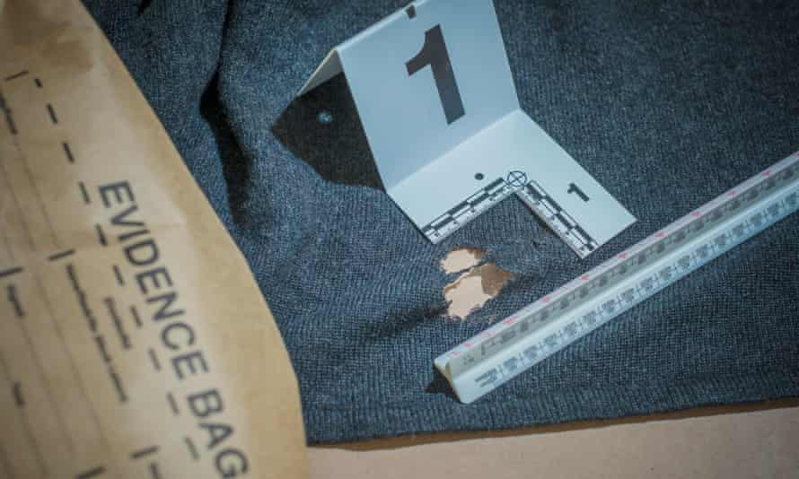 Fabric of life: a jumper is examined to give vital clues.