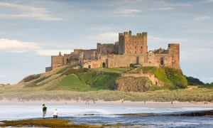 Bamburgh Castle with beach and people