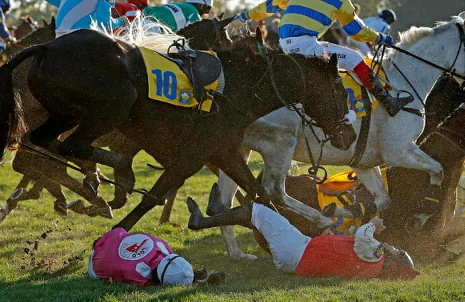 Josef Bartos (left) falls off Vocody at the Taxis fence while Thomas Boyer is unseated from Templar during the 128th Velka Pardubicka steeplechase horse race at Pardubice, Czech Republic in October 2018