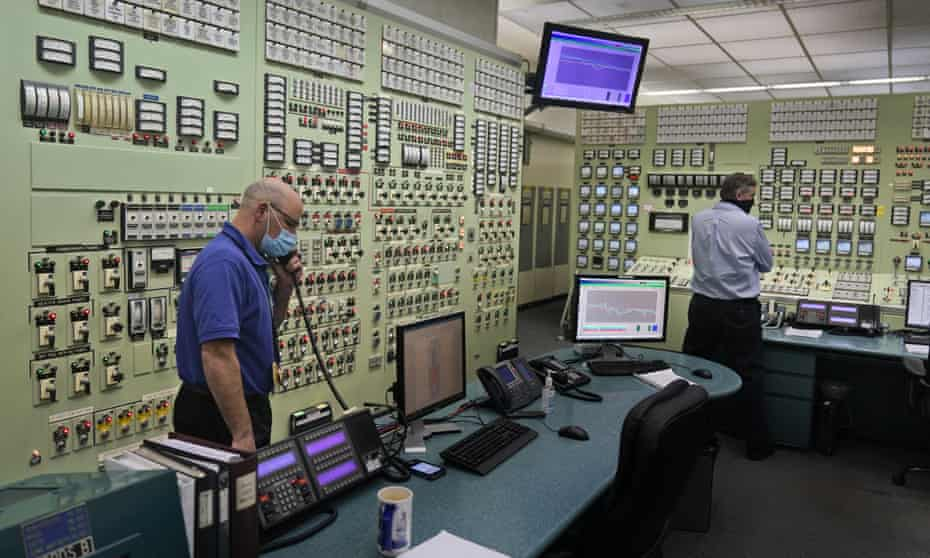 Reactor operators Eugene Vanderbeek, left, and Andrew Goerres monitor Unit 3 from a control room at Indian Point Energy Center. The plant has provided about 1,000 well-paid jobs.