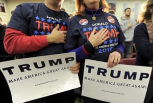Supporters of Donald Trump hold their hands to their chest as the national anthem is played at a campaign rally in Concord, New Hampshire.