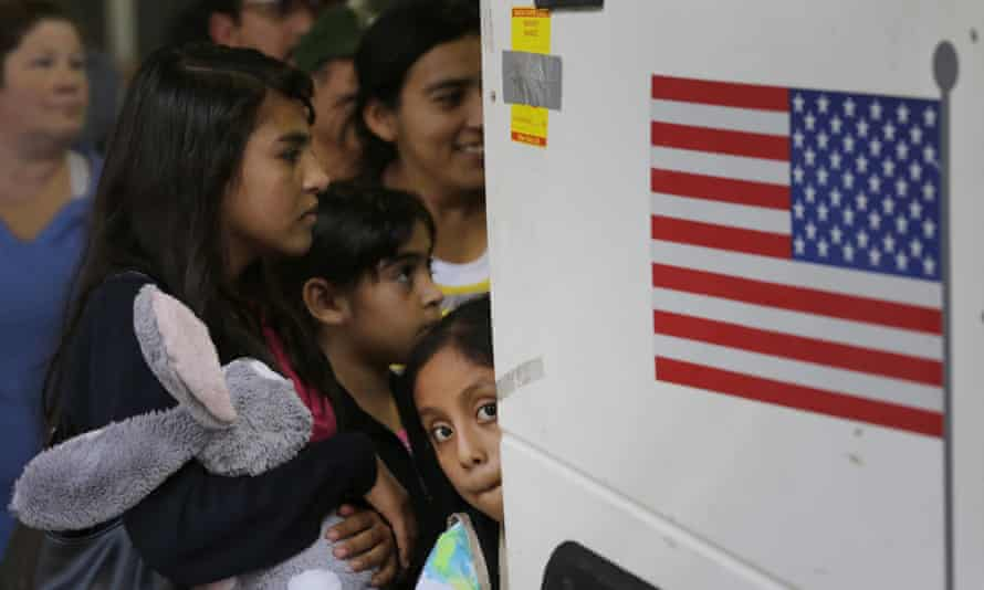 FILE - In this July 7, 2015 file photo, immigrants from El Salvador and Guatemala who entered the country illegally board a bus after they were released from a family detention center in San Antonio. A group of immigrant rights lawyers in a filing Thursday, Aug. 13, 2015, say that detention of women and children caught crossing the U.S.-Mexico border illegally is lengthy and unsafe, challenging the government's claims that immigrant families are held only briefly and that their detention doesn't violate a longstanding ban. (AP Photo/Eric Gay, File)