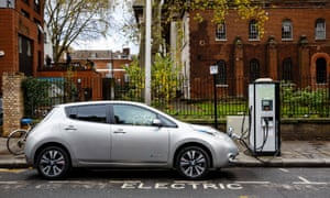 An electric vehicle on charge on a London street.