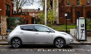 An electric car charging on a London street.