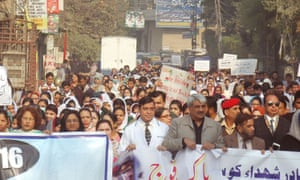 People attend a Lahore rally ahead of the upcoming first anniversary of the Peshawar school attack