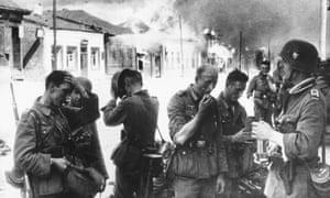 German troops in the burning ruins of Vitebsk, now in north-east Belarus, in August 1941.