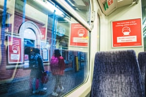 LondonTransport for London signs remind passengers to wear a mask.