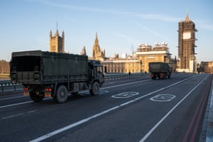 London, England  Military vehicles cross Westminster Bridge after members of the 101 Logistic Brigade delivered a consignment of medical masks to St Thomas' hospital