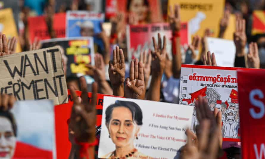 Protesters in Myanmar call for the release of the detained civilian leader Aung San Suu Kyi at a demonstration in Yangon.