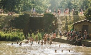 people swimming at wilderness festival in oxfordshire