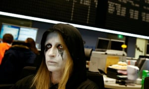 A share trader dressed in a Shrove Tuesday carnival costumes at the Frankfurt stock market today.