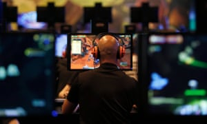 A visitor plays World of Warcraft: Warlords of Draenor at an exhibition stand during an international video games fair.