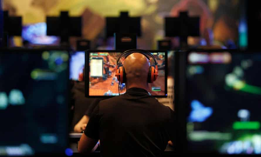 A visitor plays World of Warcraft: Warlords of Draenor at an entertainment exhibition in Cologne, Germany.