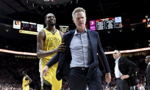 Kevin Durant helps escort his coach Steve Kerr off the court after his ejection
