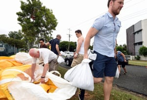 """Residents collect sandbags in the suburb of Morningside in Brisbane, Queensland, ahead of the arrival of the cyclone at 8am AEST. Authorities were warning of a """"calamity"""" and residents were told to expect """"a harrowing and terrifying experience""""."""