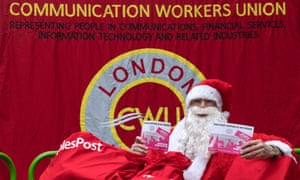 A striking postal worker dressed as Father Christmas.