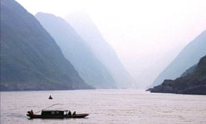 A small boat plies the Yangtze river in the Wu Xia Gorge.