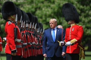 Donald Trump inspects an honour guard during a welcome ceremony at Buckingham Palace