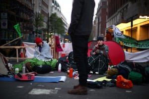 Activists sit on a road at Marble Arch
