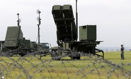 Japanese forces demonstrate Patriot missiles at the US Yokota Air Base on the outskirts of Tokyo.