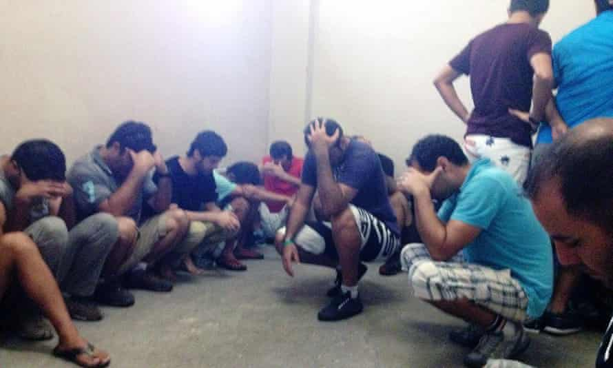 Scores of refugees arrested in March for protesting, held at a police station on Nauru. Newly released documents show that information about detainee mental health was withheld from reports at the request of the immigration department.
