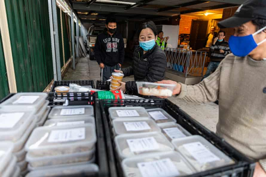 Angelina Sukiri, project coordinator of the Kasih Project preparing food to hand out at a collection point in Melbourne.