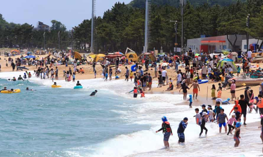 Bathers at Sokcho beach, 130 miles from Seoul, South Korea.