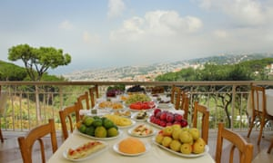 Tables laid out at Mounir restaurant, overlooking Beirut.