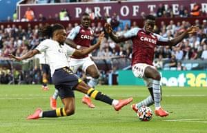Everton's Alex Iwobi challenged by Axel Tuanzebe.