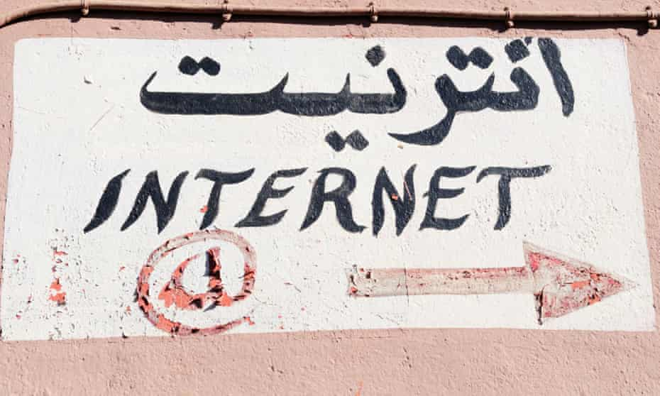 A sign in Arabic on the side of an internet cafe in Morocco.