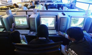 South Korean students play computer games at an Internet cafe in Seoul