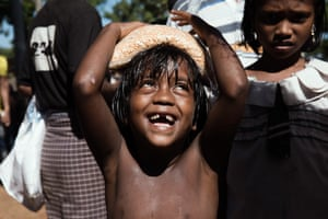 Ukhia, Bangladesh. A boy carries a bag of food on his head at the Kutupalong refugee camp