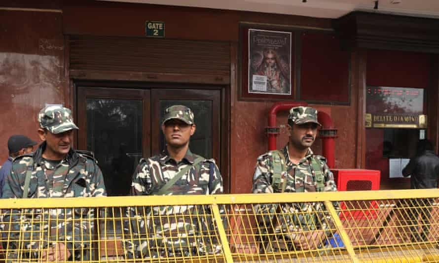 Indian Security personnel stand guard during the screening of Bollywood movie 'Padmavat' at a cinema hall in New Delhi, India