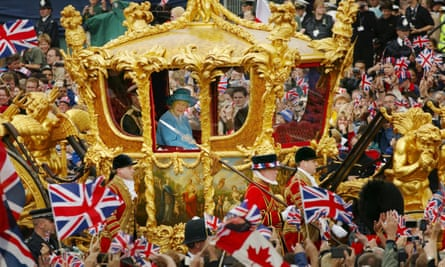 The Queen and the Duke of Edinburgh ride in the Golden State Carriage at the head of a parade celebrating her golden jubilee in June 2002.