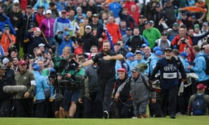 Shane Lowry celebrates on the 18th before winning the Claret Jug.