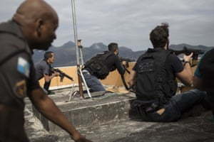 Police exchange gunfire with drug traffickers at the 'pacified' Alemao slum in Rio de Janeiro